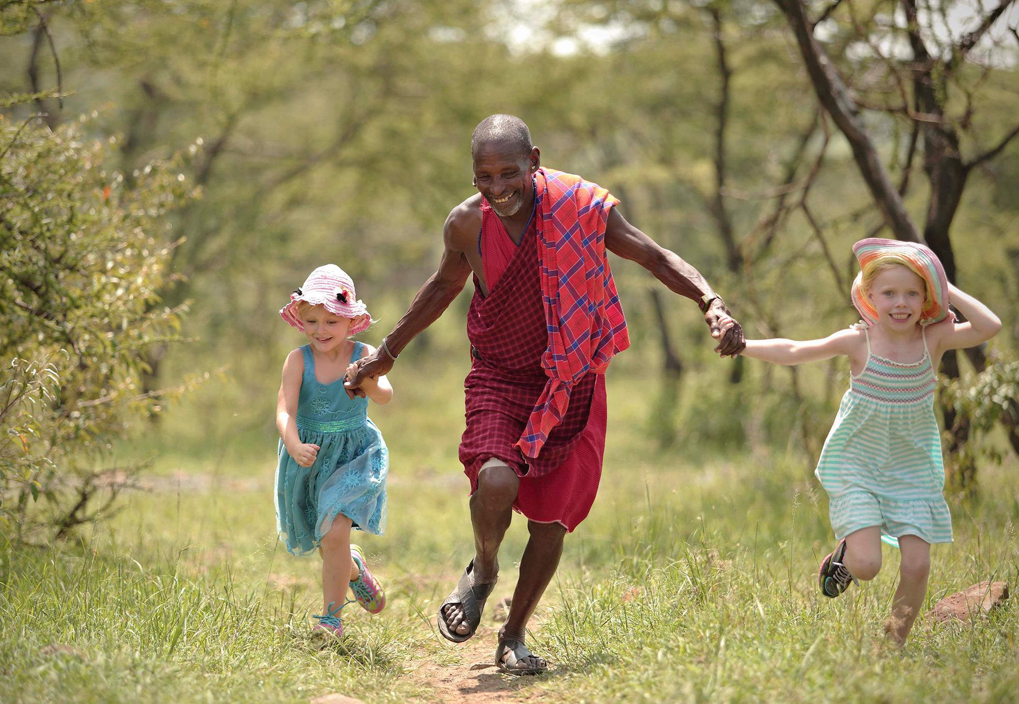 Naboisho-Camp-guide-and-children-running-Stevie-Mann.jpg